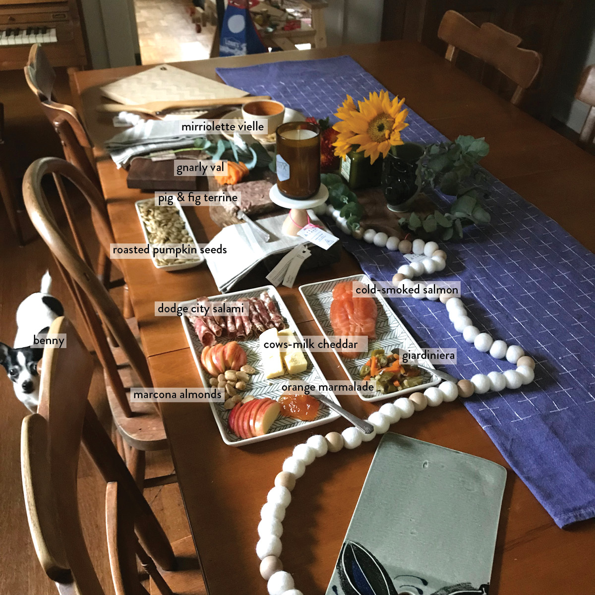 labeled charcuterie boards, chihuahua, tablescape, flowers, thanksgiving